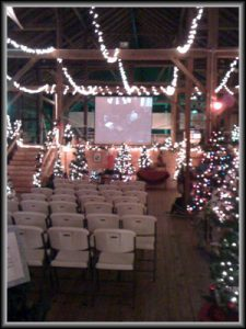 inside of barn decorated for christmas