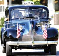 Classic car with american flags on front